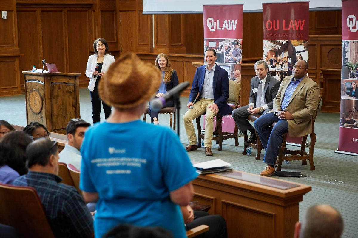 OU Law Professor Evelyn Aswad, Oklahoma City attorney Megan Lambert, Brent Harris of Facebook, Dallas attorney Robert Latham, and Robert Traynham of Facebook speak during the town hall meeting at OU Law.