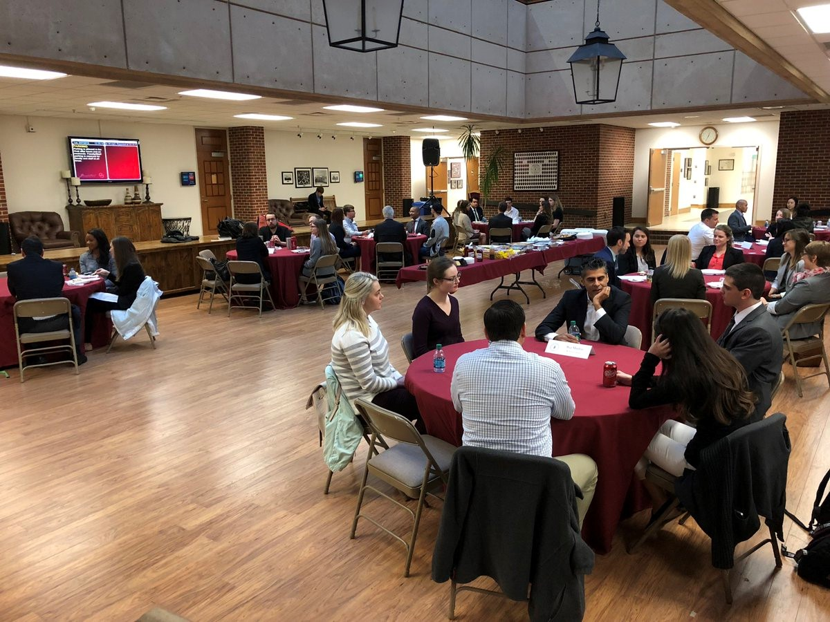 Students meeting with business and human rights experts during a speed mentoring event.