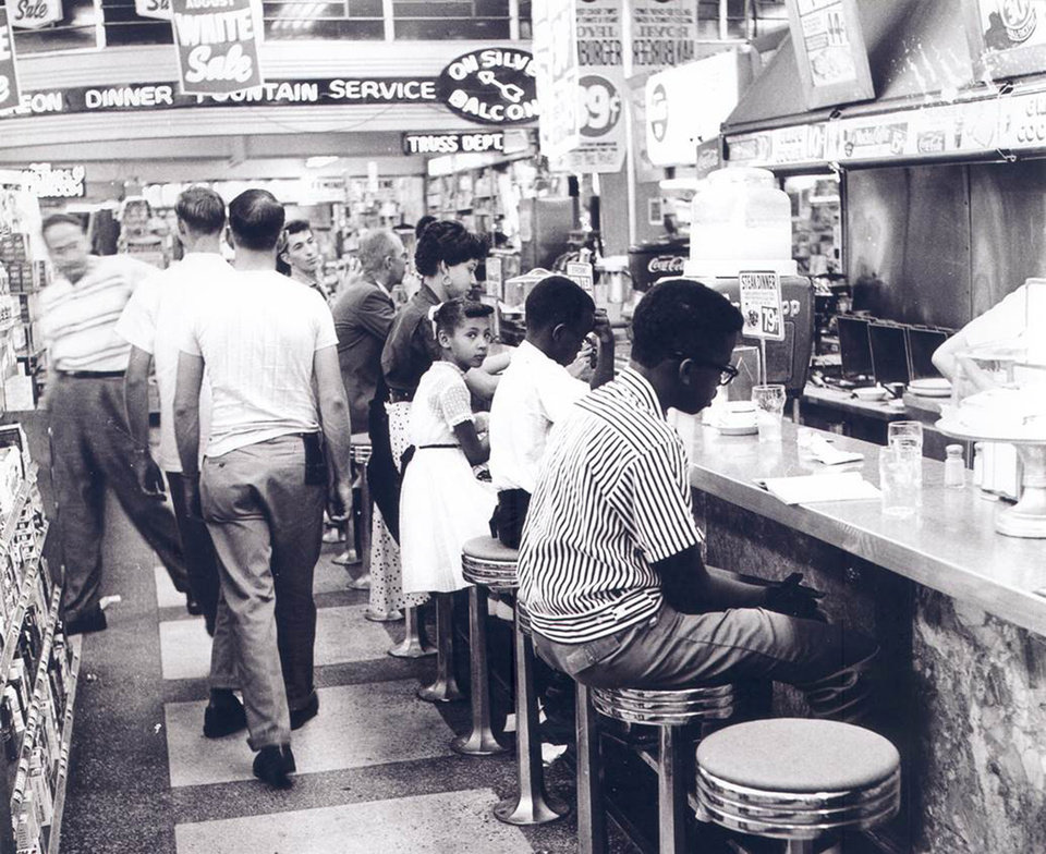 Evans (in striped shirt) sits at the Katz Drug Store counter during the Oklahoma City sit-in in August 1958. Photo courtesy of the John Melton Collection, Oklahoma Historical Society.