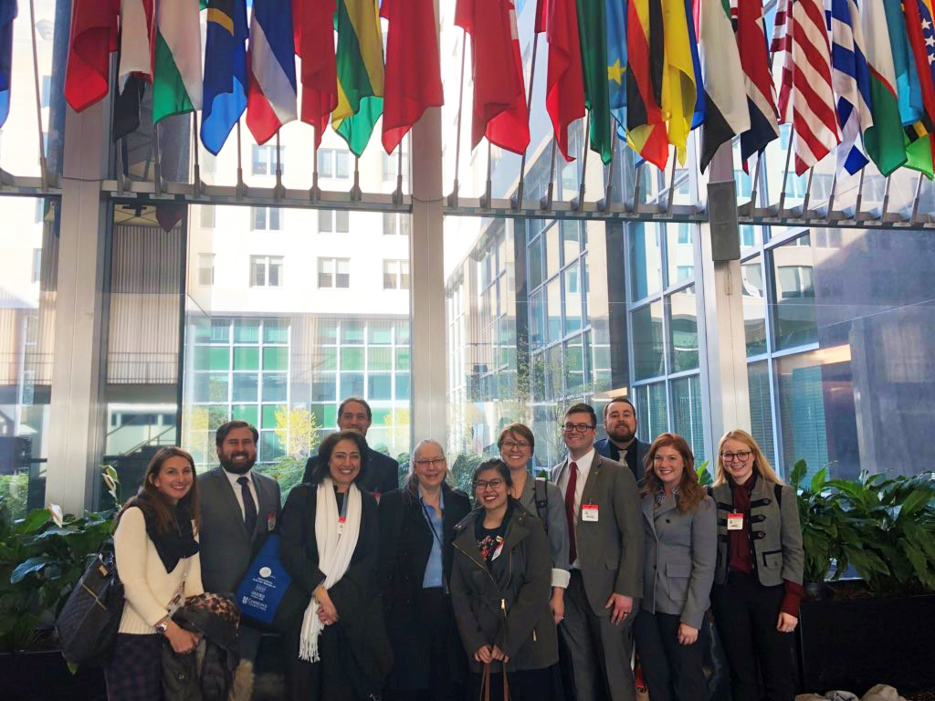 Practicum students at the State Department after presenting their research.