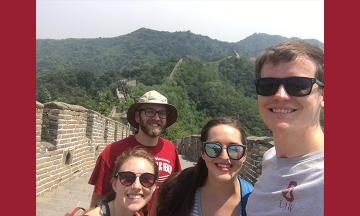 Justin Mai and other students at the Great Wall of China