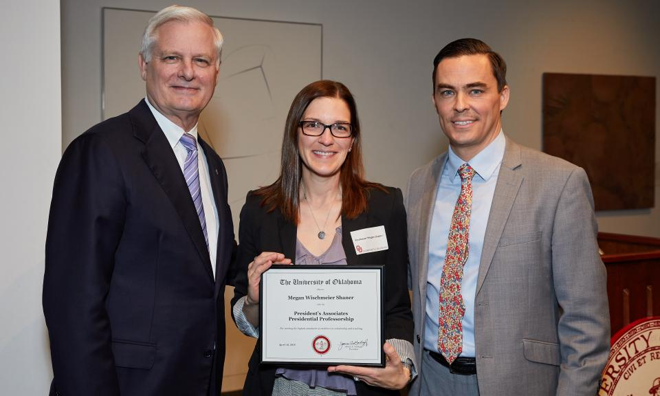 """OU President James L. Gallogly, OU Law Associate Dean for Research and Scholarship Megan Wischmeier Shaner, and OU Senior Vice President and Provost Kyle Harper at the university's """"A Tribute to the Faculty,"""" held April 16, 2019."""
