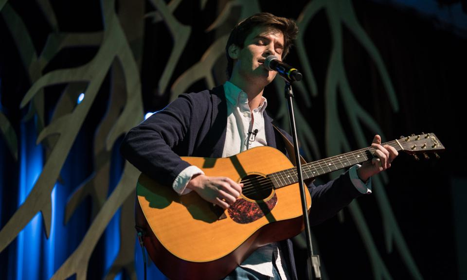 OU Law student Nick Williams plays the guitar at TEDxOU.
